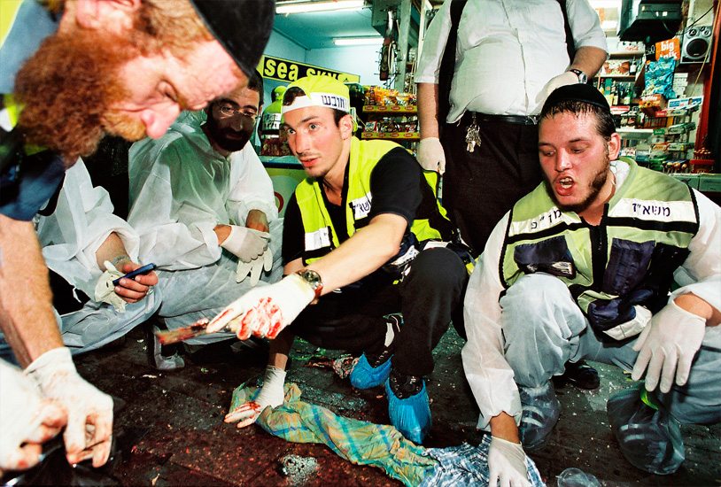 Shlomo Bloch & colleagues collecting human debris from bomb scene.