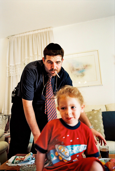 Nathan Koenig at home with his son.